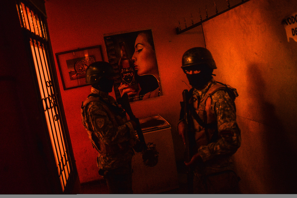 Police conduct a late-night crime sweep at a brothel in Santa Cruz, Bolivia. The government formed an emergency plan to crack down on violent crime in Santa Cruz after a rise in violent crimes authorities say is consequential of increased presence of illegal narcotraffickers from Colombia and Brazil in the area. The police crack down includes increased traffic stops, operations aimed at small-scale drug dealers and sweeps of night clubs and bordellos to check the identification documents of prostitutes and their clients, in the hopes of finding foreigners who are in the country illegally and potentially connected to drug gangs. Photo by Meridith Kohut for The New York Times