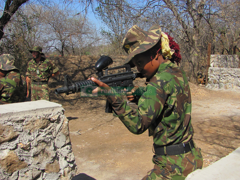 Oct. 8, 2014 - BALULE RESERVE, SOUTH AFRICA: Live fire training. LED BY BRITISH former military personnel these pictures show how courageous women anti-poachers train with guns in their battle to preserve Africa's endangered animals. Operating in the Kruger National Park's Balule Nature Reserve the 24-member strong all-female Black Mamba Anti-Poaching Unit patrols 50,000 hectares of bush to protect elephants and rhinos that are hunted as part of the estimated £12billion a year illegal world animal trade. These ladies, who as pictures show pose with weapons but also know how to party, are on the front line of a deadly war for the resources of their continent. Over the past year 1,000 wildlife rangers have been killed in Africa while protecting endangered wildlife. Black Mamba Commander and former Royal Navy serviceman Russell Baker (28) from Grimsby, UK explained exclusively how and why this South African special unit was established. (Credit Image: © Media Drum World/MediaDrumWorld/ZUMAPRESS.com)