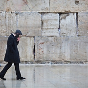 Snow and rain fall at The Western Wall on January 7, 2015 in Jerusalem, Israel. (Photo by Elan Kawesch)