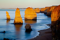 Three of the remaining Twelve Apostles are lit by the morning sun. Near Port Campbell, Australia