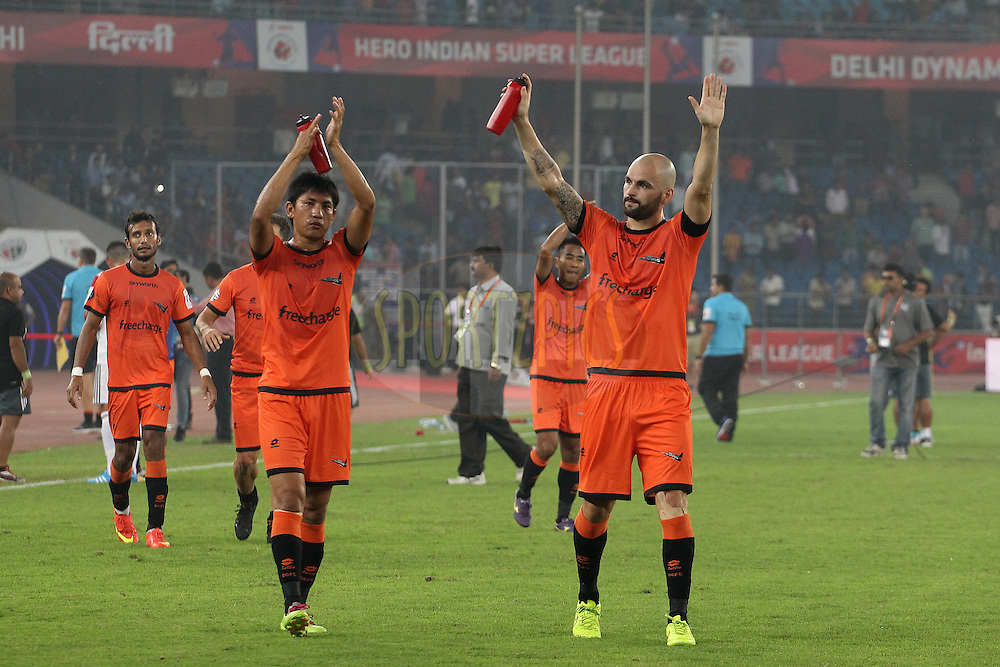 Hans Mulder of Delhi Dynamos FC acknowledges the crowd after the match during match 16 of the Hero Indian Super League between The Delhi Dynamos FC and NorthEast United FC held at the Jawaharlal Nehru Stadium, Delhi, India on the 29th October 2014.<br /> <br /> Photo by:  Ron Gaunt/ ISL/ SPORTZPICS