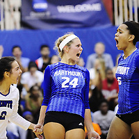 09/01/2015 - Arlington, VA: Marymount athletes #2 Courtney Phung, #24 Emileigh Rettig, & #6 Cailyn Thomas erupt with exuberance following a resounding kill late in the first set of their match against rival Stevenson.