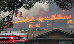 July 6, 2018 - Alpine, California, U.S. - A home burns near Olive View Road on Friday during a fire in Alpine, California. (Credit Image: © Eduardo Contreras/San Diego Union-Tribune via ZUMA Wire)