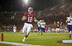 September 26, 2009; Stanford, CA, USA;  Stanford Cardinal quarterback Andrew Luck (12) scores a rushing touchdown in the fourth quarter against the Washington Huskies at Stanford Stadium. Stanford won 34-14.