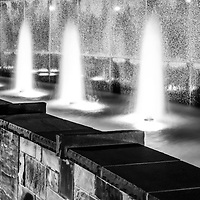 Charlotte NC fountain at Romare Bearden Park at night black and white panorama photo. Panoramic photo ratio is 1:3.