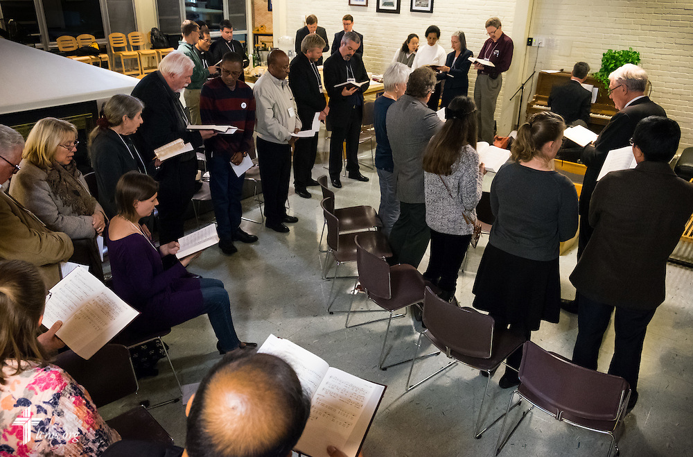 """Attendees representing ten countries pray Compline together using Lutheran Service Book, at the """"Fresh Hymns of Thankful Praise"""" symposium at Concordia Theological Seminary in Fort Wayne, Ind."""