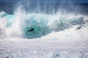 Surfer Crashing in a Big Wave at Pipeline on the Northshore in Hawaii