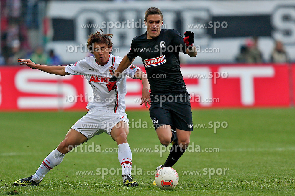 01.12.2012, SGL Arena, Augsburg, GER, 1. FBL, FC Augsburg vs SC Freiburg, 15. Runde, im Bild Zweikampf zwischen Ja-Cheol Koo (# 14, FC Augsburg) und Max Kruse (# 20, SC Freiburg) v.l // during the German Bundesliga 15th round match between FC Augsburg and SC Freiburg at the SGL Arena, Augsburg, Germany on 2012/12/01. EXPA Pictures © 2012, PhotoCredit: EXPA/ Eibner/ Peter Fast..***** ATTENTION - OUT OF GER *****