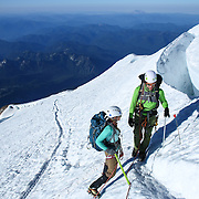 Climbing teams cross paths during a summit of Mount Rainier on June 30, 2015. The iconic Pacific Northwest volcano is a popular challenge for mountaineers.  (Joshua Trujillo, seattlepi.com)