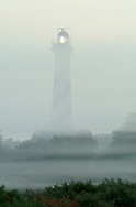 Lighthouse in fog near Burgh Haamstede, Zeeland, Netherlands.