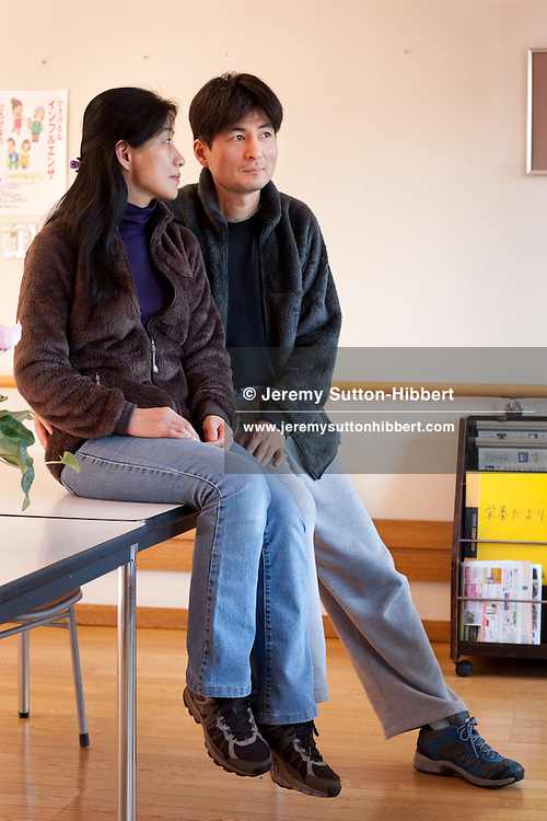 Hiromaru Sasazaki, survivor of the March 11th 2011 tsunami, and his wife Nobuko, prior to his hospital appointment where he undergoes rehabilitation for his injured knee, at hospital in Morioka city, Iwate prefecture, Japan, on Thursday 26th January 2012.