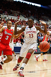 March 21, 2011; Stanford, CA, USA; Stanford Cardinal forward Chiney Ogwumike (13) watches the ball go out of bound in front of St. John's Red Storm forward Da'Shena Stevens (3) during the first half of the second round of the 2011 NCAA women's basketball tournament at Maples Pavilion.