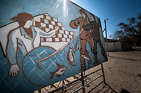 A sign is seen in an abandoned fish processing factory in the town of Moynak.