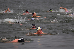 © Licensed to London News Pictures. 25/12/2012. London, UK. Members of the Serpentine Swimming Club swim in the Serpentine as they compete in the Serpentine Swimming Club's annual Christmas morning 'Peter Pan Cup' race in Hyde Park, London, today (25/12/12).   The race, which takes place every Christmas Day on the Serpentine River, takes its name from from the novel by J.M.Barrie after the author presented the first Peter Pan Cup in 1904. Photo credit: Matt Cetti-Roberts/LNP