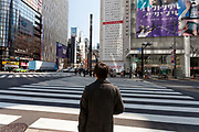 A man looks at a  large billboard on the side of the Sony Building in Ginza marks the sixth anniversary of the March 11th 2011 earthquake and tsunami in Tohoku. Ginza, Tokyo, Japan. Friday March 10th 2017 The billboard was created by Yahoo and shows the asks passers by to remember the disaster and the nearly 16,000 people who died. the line marked in red shows the maximum height of the tsunami (16.7 metres at Ofunato in Miyagi prefecture. The billboard is on display until March 12th.