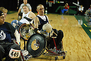 July 7th, 2006: Anchorage, AK - David Nau (7) picks the ball up for a pass as White defeated Blue in the gold medal game of Quad Rugby at the 26th National Veterans Wheelchair Games.