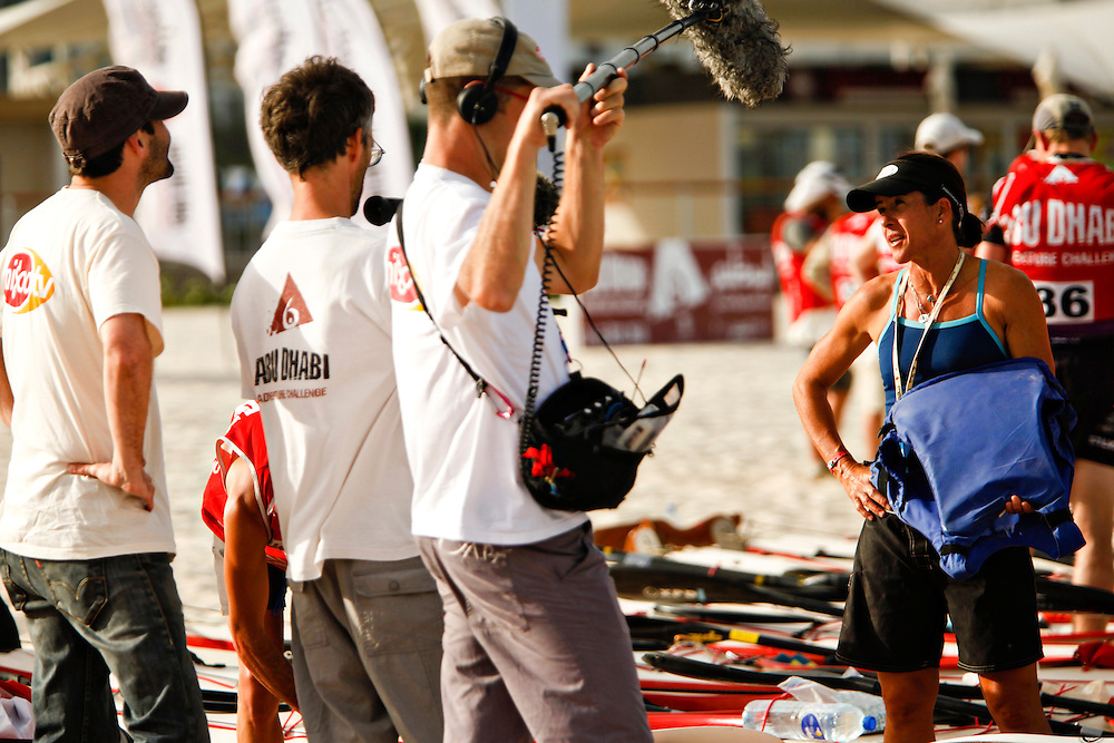 Sheila Taormina of the Yankee Scribes is interviewed by a crew from Migoo TV. Taormina drew consitant attention from Migoo and other media. ..4th Annual Abu Dhabi Adventure Challenge..December 10th through December 15th, 2010. ..The Abu Dhabi Adventure Challenge (ADAC) is a 6 Day staged endurance race consisting of disciplines such as mountain biking, trekking, canoeing, sea kayaking, abseiling, running, and swimming. Coed teams of 4 will attempt to tame this beast of a course through the beautiful Emirate of Abu Dhabi, UAE..Photo by Chris Radcliffe