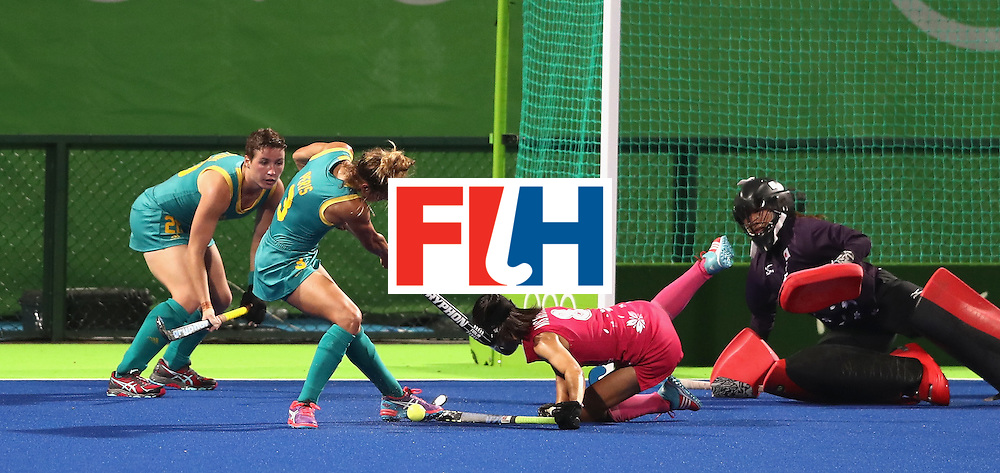 RIO DE JANEIRO, BRAZIL - AUGUST 13: Ayaka Nishimura of Japan is struck on the head by the stick of Peris Brooke during the Women's Pool B hockey match between Australia and Japan on Day 8 of the Rio 2016 Olympic Games at the Olympic Hockey Centre on August 13, 2016 in Rio de Janeiro, Brazil.  (Photo by David Rogers/Getty Images)