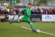AFC Wimbledon goalkeeper Joe McDonnell (24) clearing the ball during the EFL Sky Bet League 1 match between AFC Wimbledon and Peterborough United at the Cherry Red Records Stadium, Kingston, England on 17 April 2017. Photo by Matthew Redman.