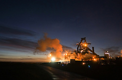 © Licensed to London News Pictures. <br /> 07/01/2015. <br /> <br /> South Gare, Teesside<br /> <br /> The first rays of light spread out over the steel works at South Gare at Redcar on Teesside.<br /> <br /> Photo credit : Ian Forsyth/LNP