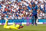 England ODI wicket keeper Jos Butler punches one through for a boundary evading Australia ODI batsman Travis Head during the 5th One Day International match between England and Australia at Old Trafford, Manchester, England on 24 June 2018. Picture by Simon Davies.
