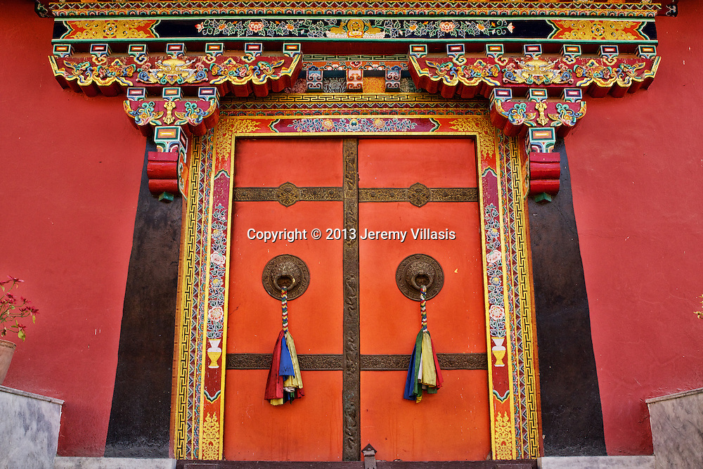 Door at the Shechen Monastery near Boudhanath Stupa in Kathmandu Valley.<br />