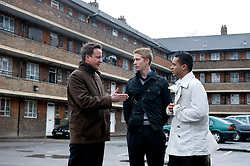 Leader of the Conservative Party David Cameron visits the Ocean Estate in Stepney, east London where he was shown around by 'London Citizens' Shahin Ahmed(R) and Matthew Bolton (M) who are trying to improve the estate for local residents, Wednesday March 31, 2010. Photo By Andrew Parsons / i-Images.