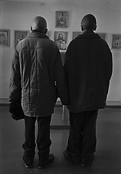 Russian young prisoners pray in the internal church of the colony for prisoner's children in Siberian town Leninsk-Kuznetsky, Russia, 25 January 2001.