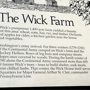 Placard about the Henry Wick Farm. The Henry Wick 18th century farm in Jockey Hollow National Park, New Jersey, USA. Parts of the American Revolution's Continental Army wintered at the farm and the rest of Jockey Hollow in 1779-1782.