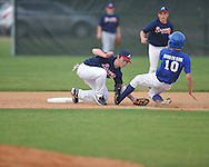 The Braves' Kyle Jackson (left) tags out the Rangers' Turner Bulock (10) on a steal attempt in Oxford Park Commission baseball action at FNC Park in Oxford, Miss. on Monday, April 25, 2011.