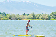 Pedaling a stand up paddle board on the Snake River in Burley, Idaho.