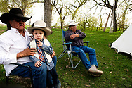 Henry Real Bird, grandson John, brother Richard, at daughter Lucy graduation celebration, alongside Little Bighorn River, at Medicine Tail Coulee site of Battle of the Little Bighorn, Crow Indian Reservation, Montana