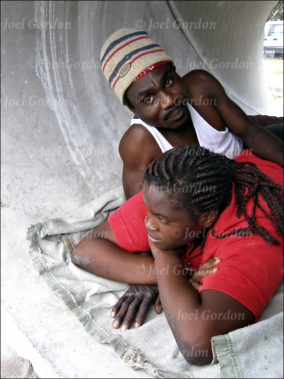 African American couple sleeping and living in very large water pipe, homeless, street people, living in large water pipe with girl friend who is pregnant,homeless on the streets  of Orlando.<br />