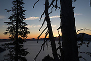 Sun breaks over the rim, Crater Lake