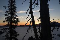 Sun breaks over the rim, Crater Lake