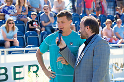 LIVERPOOL, ENGLAND - Sunday, June 24, 2018: Ken Skupski, (GBR) talks with Radio City DJ Simon Greening during day four of the Williams BMW Liverpool International Tennis Tournament 2018 at Aigburth Cricket Club. (Pic by Paul Greenwood/Propaganda)