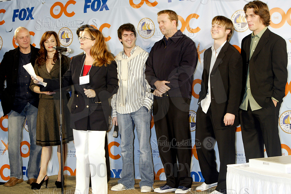 Oct 28, 2004; Newport Beach, CA, USA; Cast & Producers of the FOX hit TV show 'The OC' visited the Balboa Penninsula in Newport Beach to get a Key to the City and be immortalized in cement with thier hand prints to be placed at the enterance to the Historic Balboa Pavillion.  Seen here with Marta Hayden of the Newport Beach Visitors Bureau.  Mandatory Credit: Photo by Shelly Castellano/ZUMA Press.
