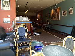 © London News Pictures. 16/05/2015. The scene where a Porsche car crashed in to a Cafe Nero coffee shop in Gerrards Cross in Buckinghamshire, UK. The driver was treated for minor injuries and a man and woman were temporarily trapped inside the shop. Photo credit: Beatrix Li/LNP