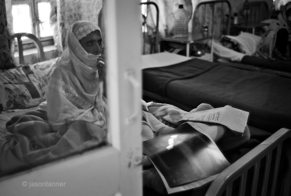 Elderly women recieve treatment in seperate wards at Samli Sanatorium...Located in the hills near Murree 40km North of Islamabad, is the Dr Syed Mohammed Hussain Government TB Sanatorium..Samli sanatorium is heaven-sent for TB patients who require a clean, pristine environment and pollution-free air to breathe...The sanatorium was established in the late 1920s by a local Muslim doctor and philanthropist Syed Mohammed Hussain, after whom the institution is named. The sanatorium has a capacity of 360 beds and treats patients with a variety of pulmonary diseases included TB and the more dangerous MDR / XDRTB...Patients admitted for treatment range from teenagers to the elderly. The sanatorium has a policy of non-isolation. Patients can lead normal lives and do not be isolated. According to chest specialist Dr Shahzada Athat, patients already bear the burden of social stigma that people create around a patient suffering with TB. They advocate treatment, which can be provided at home...The sanatorium follows the DOTS (Directly Observed Treatment Courses) policy directive issued from World Health Organisation (WHO) where a person of social standing or responsibility (teacher or health worker) observes the administration of medicines by the patient...Following an intensive phase of initial therapy and further eight months of treatment, the patient becomes non-infectious. Patient care at the sanatorium is free courtesy of government funding..