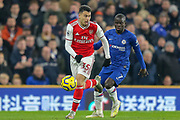 Chelsea midfielder Ngolo Kanté (7) battles for possession with Arsenal forward Gabriel Martinelli (35) during the Premier League match between Chelsea and Arsenal at Stamford Bridge, London, England on 21 January 2020.
