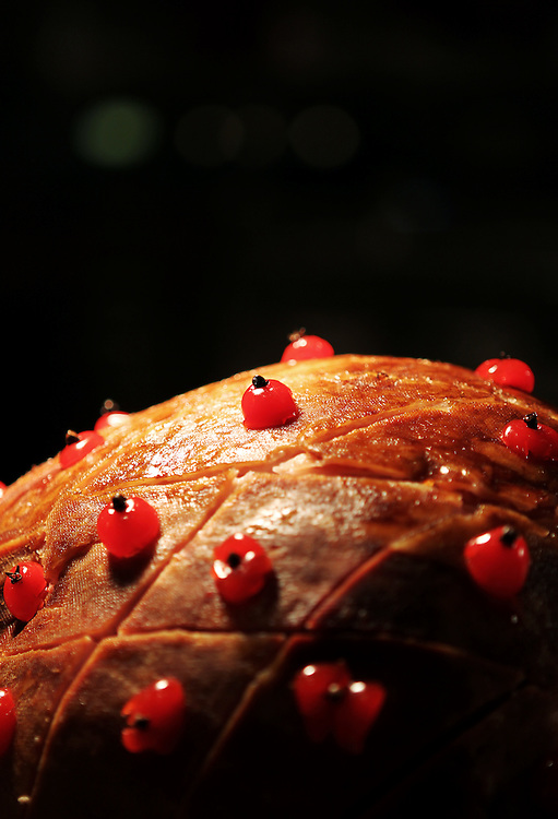 Baked ham is one of the offerings at the carving station in the Grand Buffet at Grand Casino Hinckley December 20, 2011.