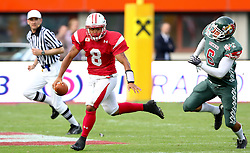 15.07.2011, Ernst Happel Stadion, Wien, AUT, American Football WM 2011, Japan (JAP) vs Mexico (MEX), im Bild Muñoz Jesús alfredo (Mexico, #6, EXT) tries to catch Tetsuo Takata (Japan, #8, QB)  // during the American Football World Championship 2011 game, Japan vs Mexico, at Ernst Happel Stadion, Wien, 2011-07-15, EXPA Pictures © 2011, PhotoCredit: EXPA/ T. Haumer