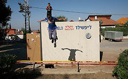Sderot  - May 2nd ,  2008 -  A young boy jumps off  a bomb shelter in the centre of Sderot, Southern Israel, The small town has frequent rocket attacks from Gaza, May 2nd, 2008. Picture by Andrew Parsons / i-Images