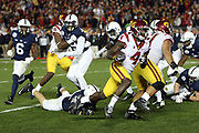 USC Trojans running back Ronald Jones II (4) runs for a 3 yard touchdown that cuts the Penn State Nittany Lions fourth quarter lead to 49-42 during the 2017 NCAA Rose Bowl college football game against the Penn State Nittany Lions, Monday, Jan. 2, 2017 in Pasadena, Calif. The Trojans won the game 52-49. (©Paul Anthony Spinelli)