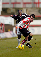 Photo: Leigh Quinnell.<br /> Brentford v Swansea City. Coca Cola League 1.<br /> 26/12/2005. Swanseas Adrian Forbes can't find a way past Brentfords Sam Tillen.