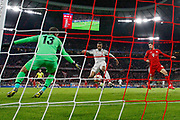 GOAL 1-1 Liverpool defender Joel Matip (32) scores an own goal during the Champions League match between Bayern Munich and Liverpool at the Allianz Arena, Munich, Germany, on 13 March 2019.