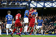 Liverpool defender Virgil van Dijk (4) Liverpool defender Joel Matip (32) and Everton defender Michael Keane (4) go up for the cross ball during the Premier League match between Everton and Liverpool at Goodison Park, Liverpool, England on 3 March 2019.