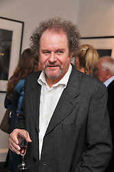 MIKE FIGGIS at a private view of an exhibition of photographs by Mike Figgis entitled 'Kate & Other Women' held at The Little Black Gallery, 13 A Park Walk, London SW10 on 22nd June 2011.
