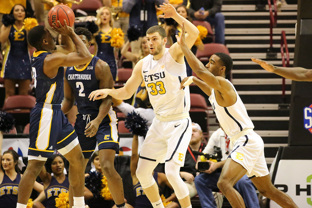 March 3, 2018 - Asheville, North Carolina - U.S. Cellular Center: ETSU forward Mladen Armus (33), ETSU guard Desonta Bradford (1)<br /> <br /> Image Credit: Dakota Hamilton/ETSU