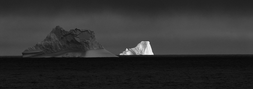 Icebergs from Greenland, drifting on Iceberg Alley. Baffin Bay.  Baffin Island. High Arctic. Canada<br /> ( environment, global warming, ice, snow, white, blue, turquoise, inmense, mass, block, glacier, foggy, fog, ocean, arctic circle, winderness, view, trip, exploration, wild, scenic, scenics, seascape, tourist, cold